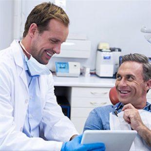 Dentist reading a chart